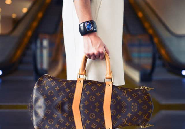 woman carrying a pretty bag